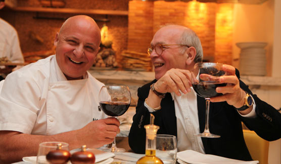 Aldo Zilli L and San Carlo Group Chairman Carlo Distefano toasting the news