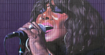 Hulme receives a Tribute to singer Denise Johnson from Artist Akse